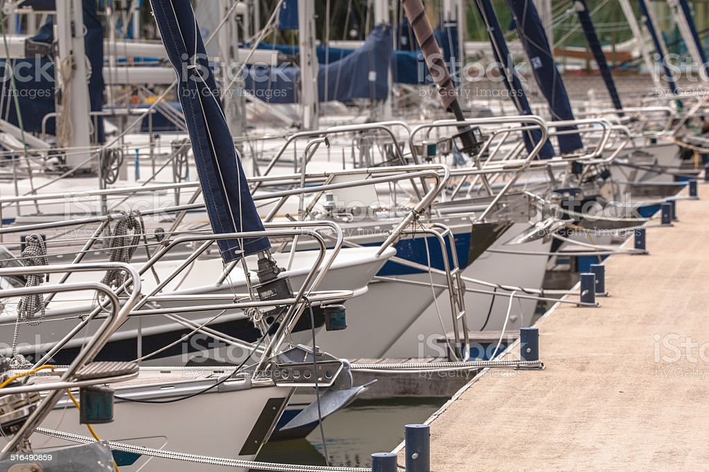 Bows of Sailing Boats Parked in a Harbor stock photo