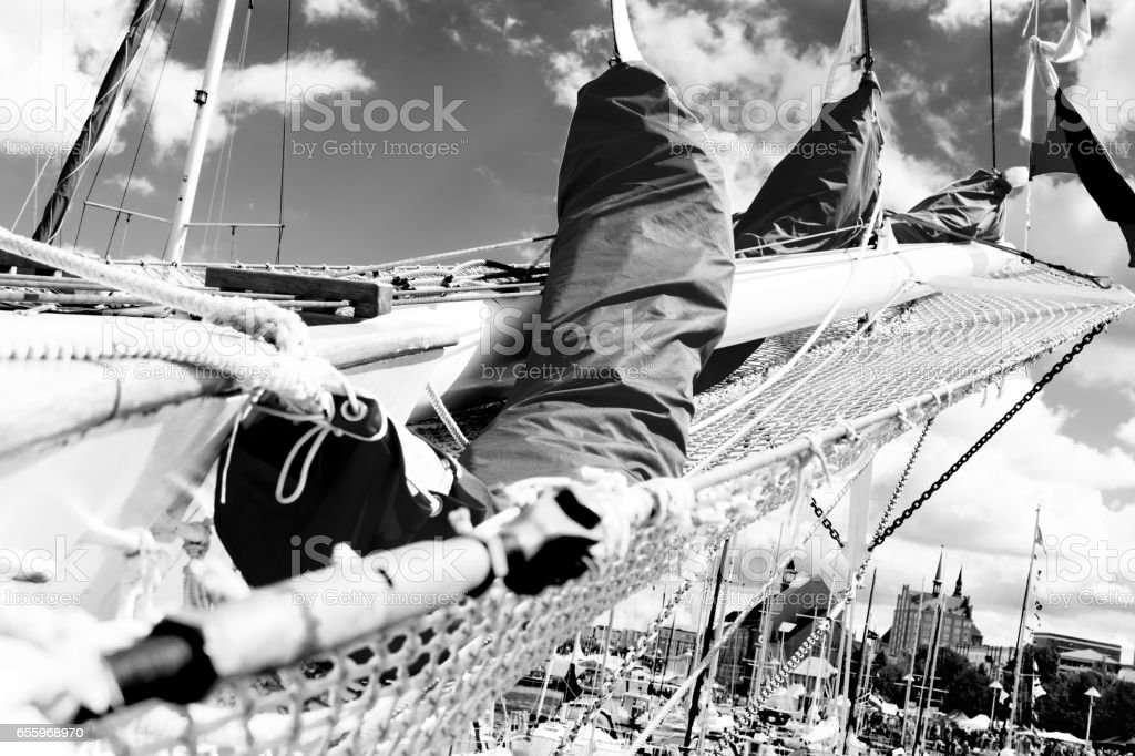 Bowsprit and gathered sail of the sailing ship. stock photo