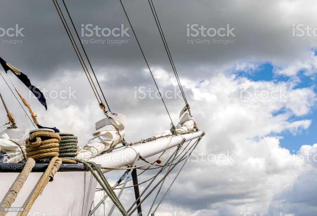 Bowsprit and rope coiled up of the sailing ship. stock photo
