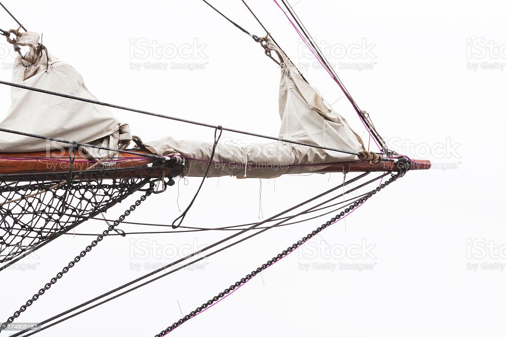 Bowsprit of old sailing ship against white background, copy space royalty-free stock photo