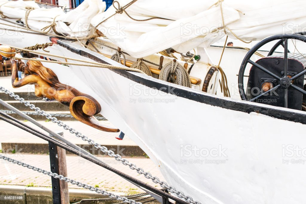 Bowsprit, Steering wheel and Belayingl pins of the sailing ship. stock photo