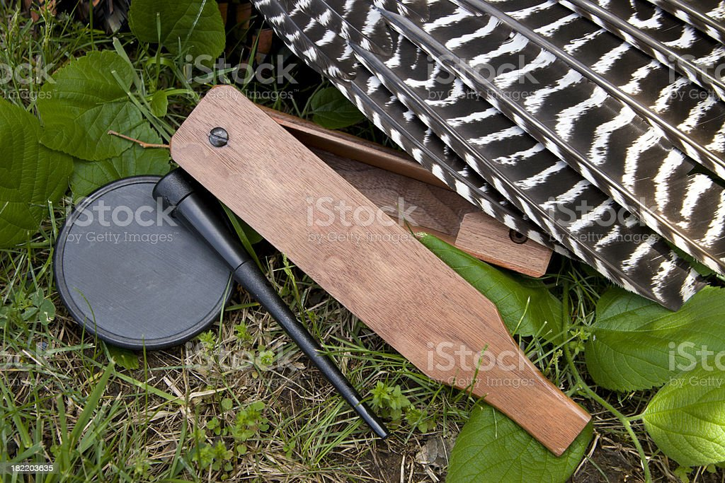 Box and slate calls with Wild Turkey wing stock photo