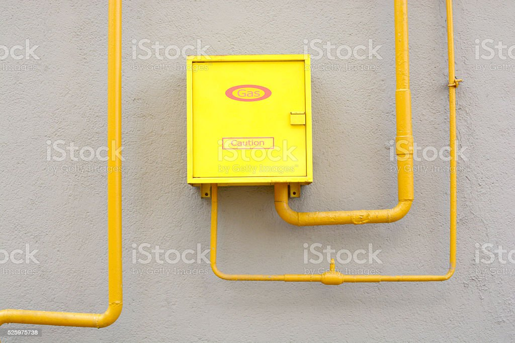box and the gas pipe on the wall stock photo