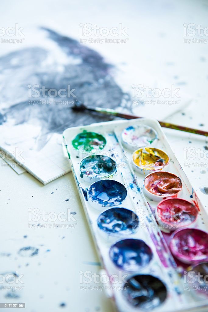 box aquarelle paints brush scribbled notebook stock photo
