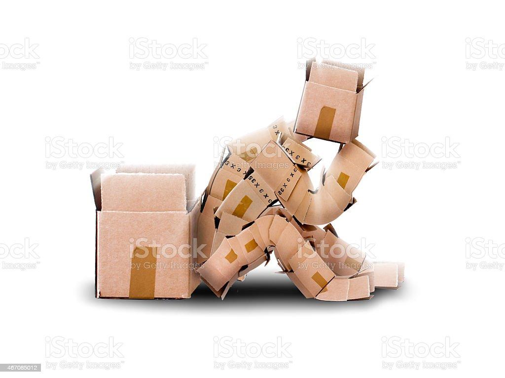 Box character sat thinking on white background stock photo