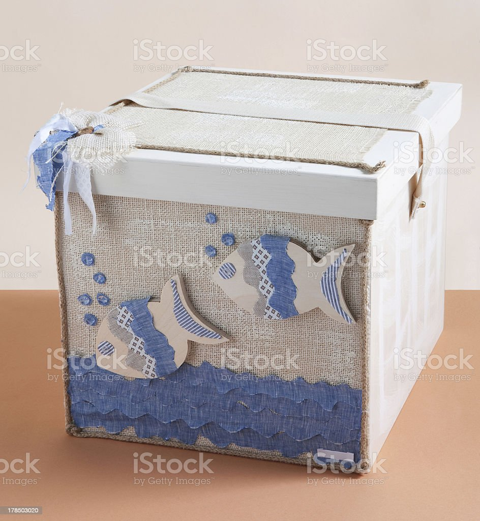 box for baptismal clothes on beige and salmon background royalty-free stock photo