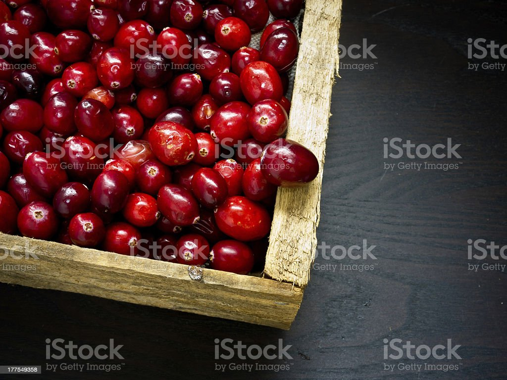 Box full of red ripe cranberries royalty-free stock photo