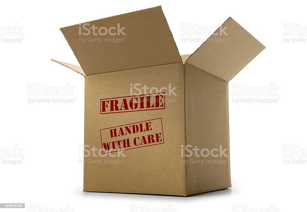 Box labeled fragile and handle with care on white background stock photo