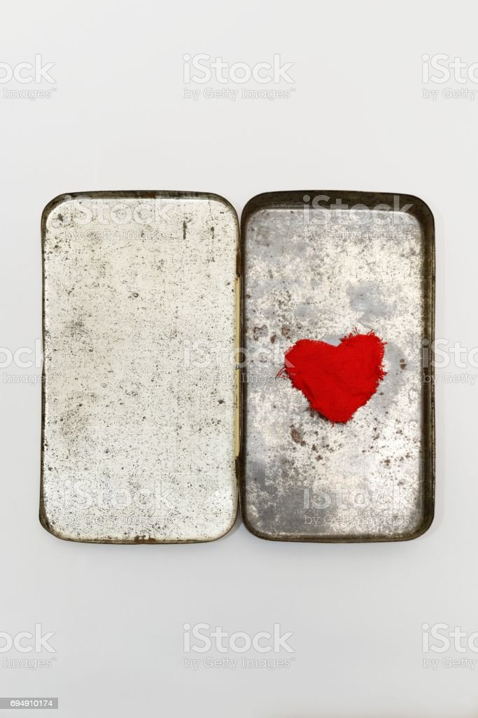 A box made of metal with a red heart in it stock photo