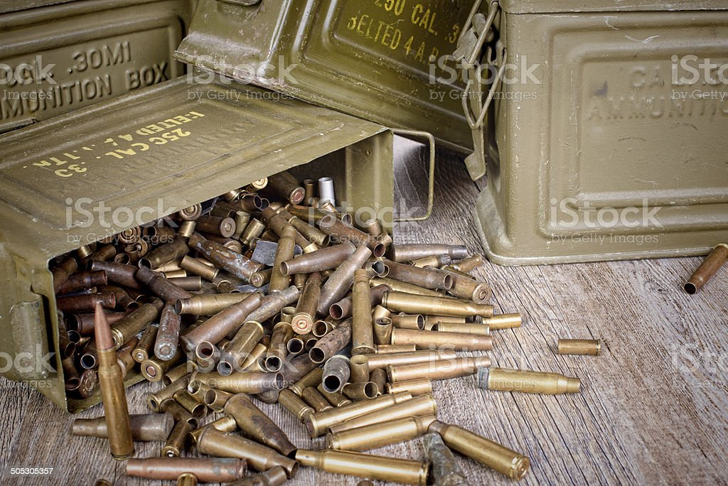 box of ammunition with empty cartridges stock photo