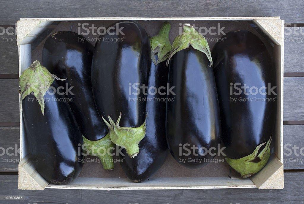 Box of aubergines stock photo
