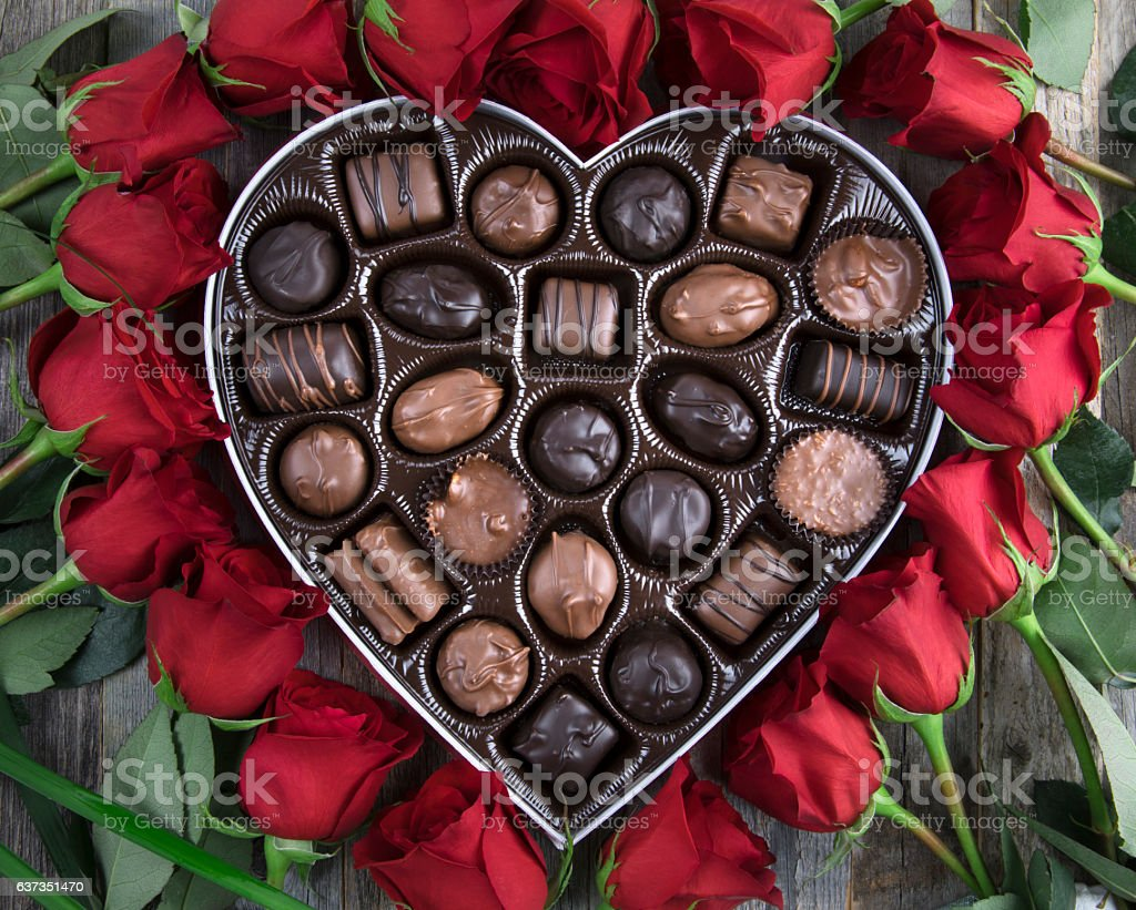 Box of Chocolates and Red Roses stock photo
