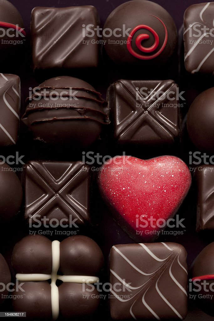 A box of different shaped chocolates stock photo