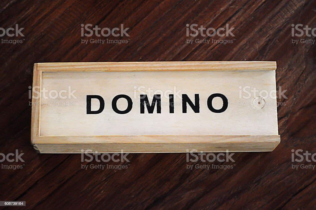 Box of domino on wooden background. stock photo