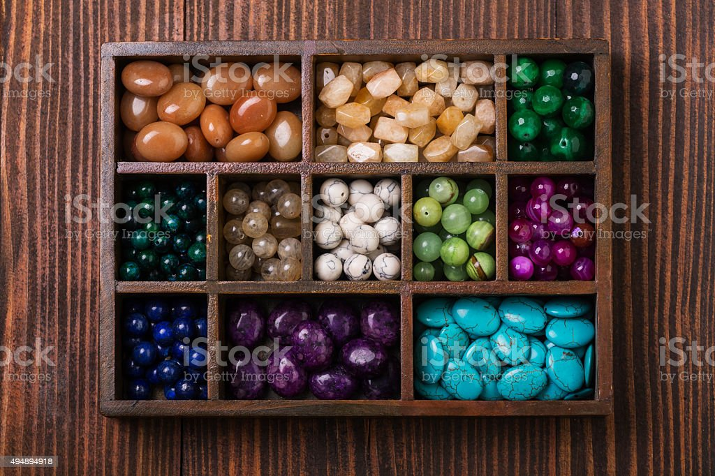 Box of gemstones upper view stock photo