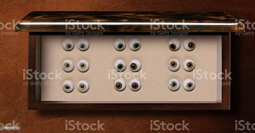 Box of Glass eyes stock photo