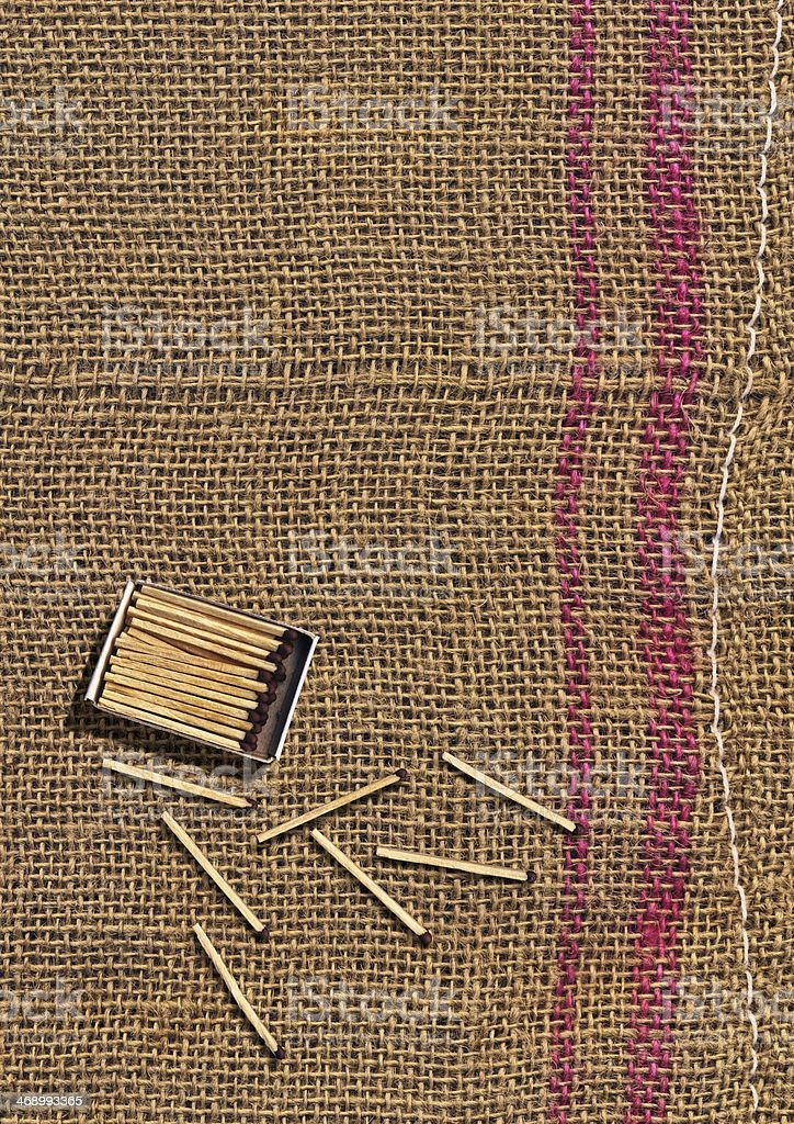 Box Of Matches Scattered On Burlap Sack Background stock photo
