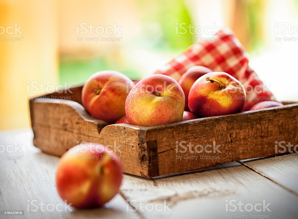 Box of nectarines stock photo