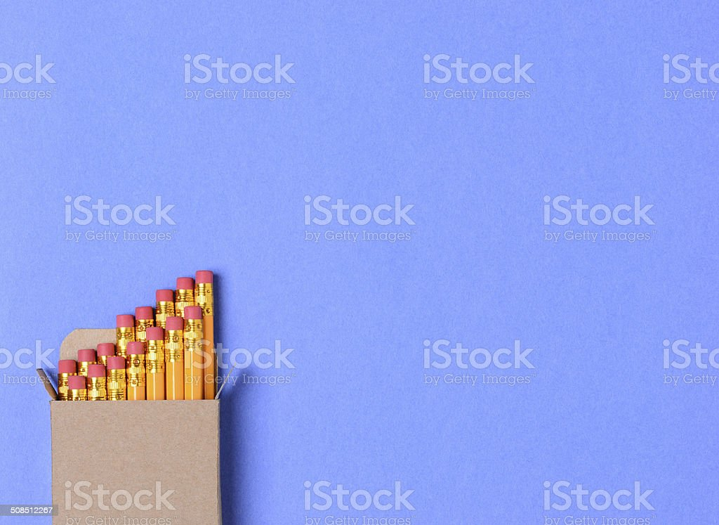 Box of Pencils on Blue stock photo