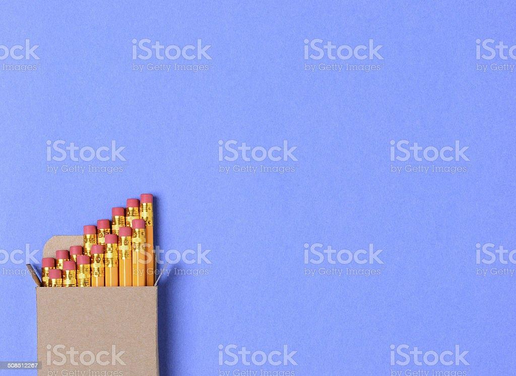 Box of Pencils on Blue stock photo