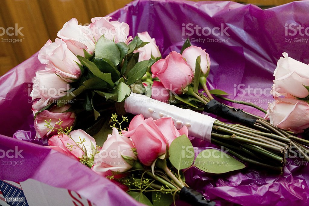 Box of Pink & Red Rose Bouquets at wedding ceremony stock photo