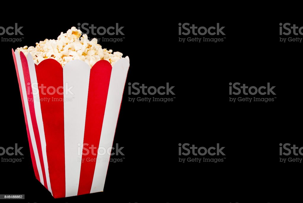 Box of popcorn on black background and space for text stock photo