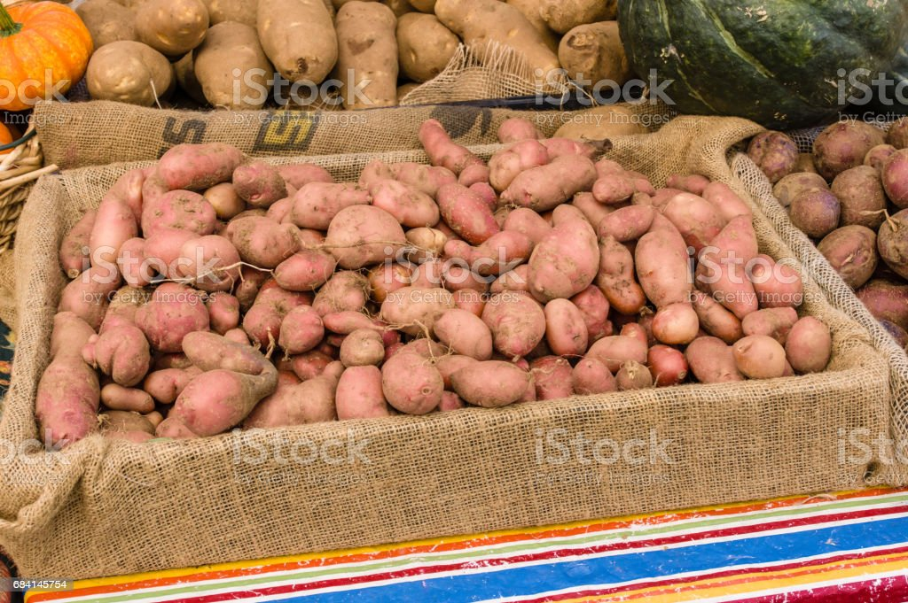 Box of red potatoes at the market stock photo