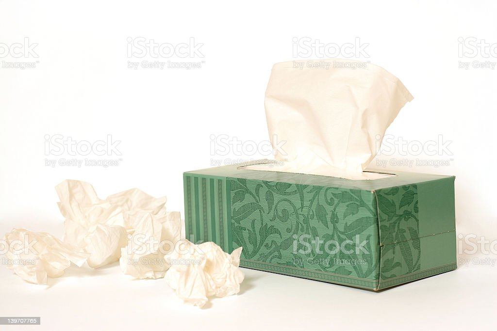 A box of tissues with used tissues next to it  stock photo