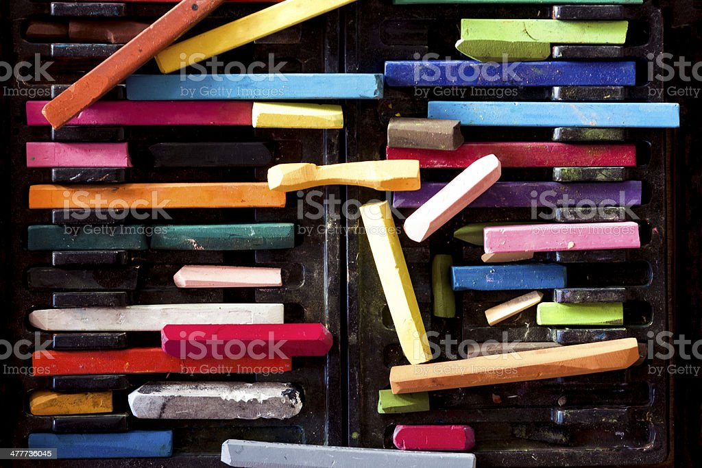 Box of used colourful pastels in black palstic box royalty-free stock photo
