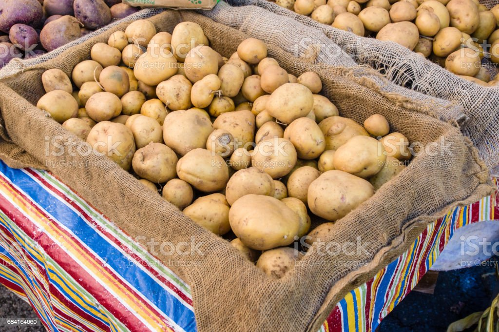 Box of white potatoes at the market stock photo