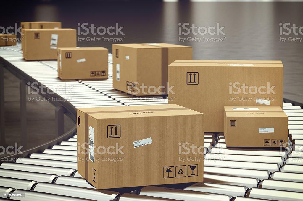 Box on conveyor roller stock photo