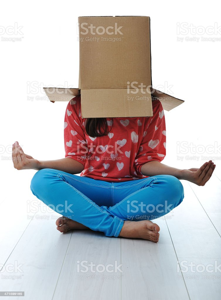 Box on human head doing yoga excercise royalty-free stock photo