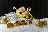 Box with a gift and New Year decorations