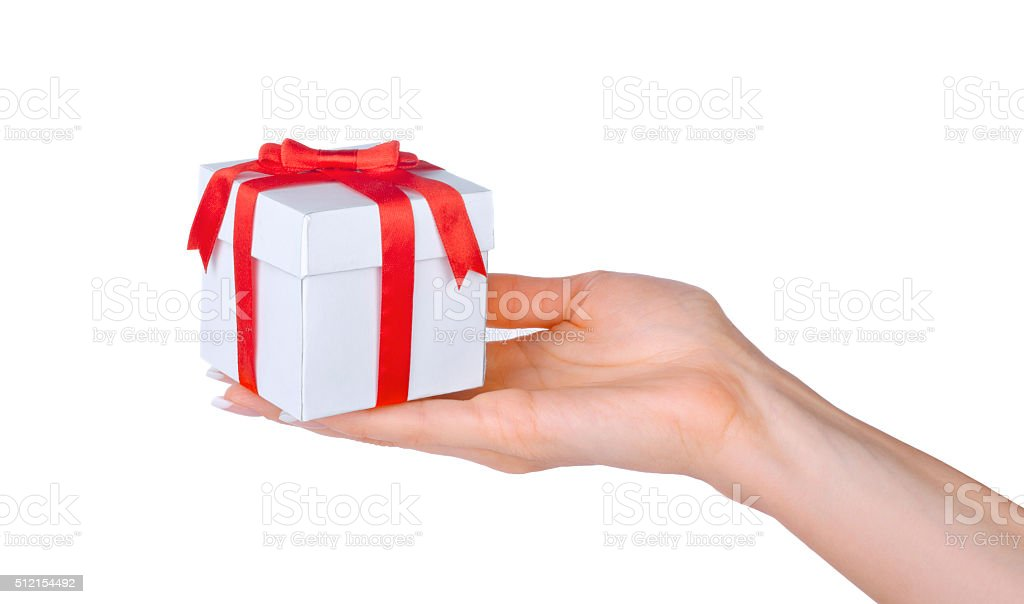 Box with a gift in the hand of woman isolated stock photo