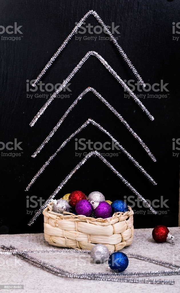 Box with Christmas decorations and abstract fir-tree from tinsel stock photo