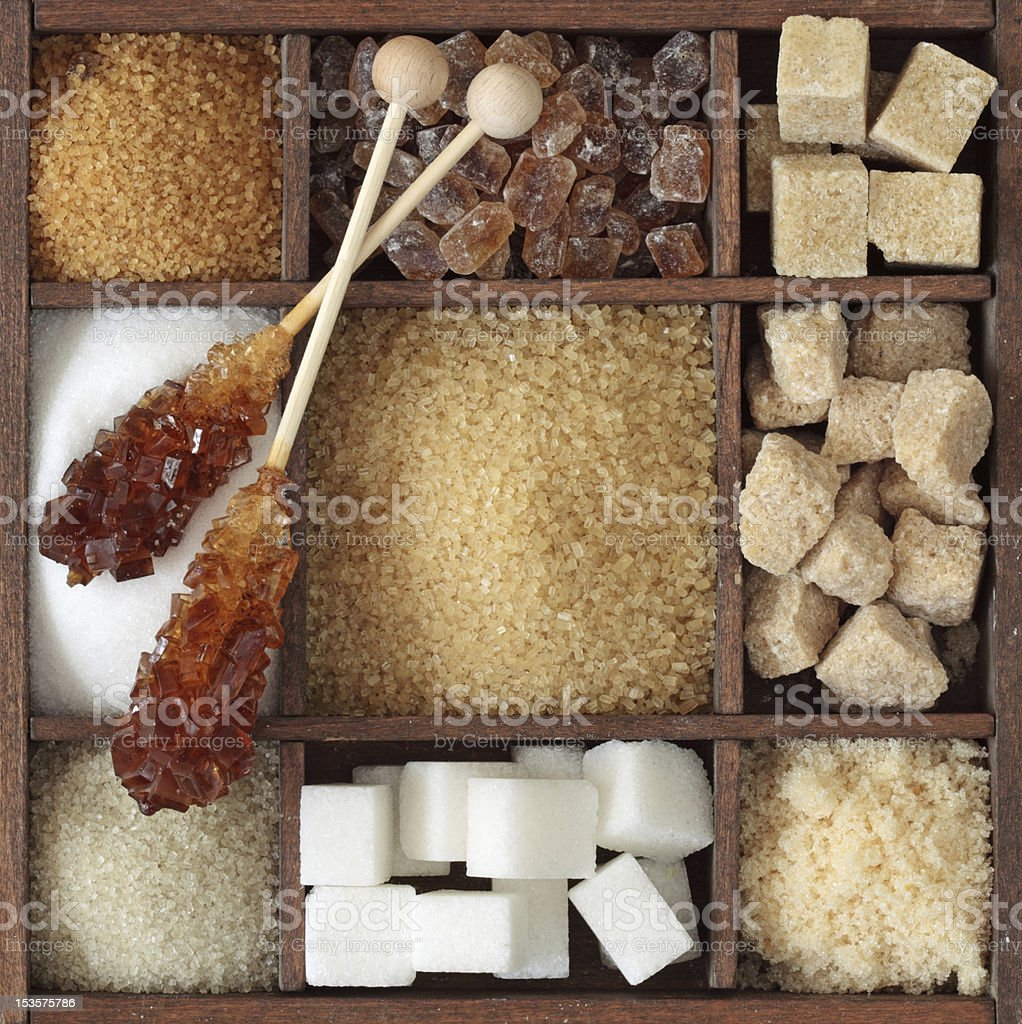 A box with different types of sugars stock photo