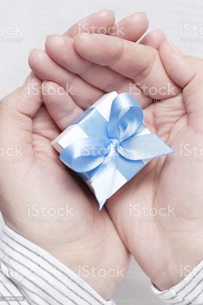 Box with gift in their hands royalty-free stock photo