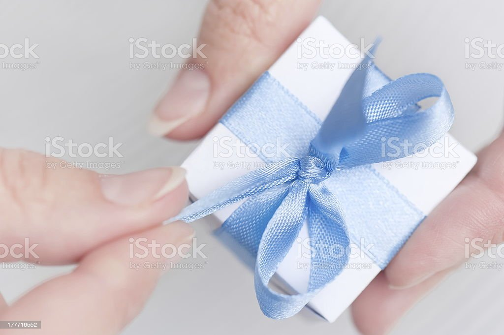 Box with gift in their hands stock photo
