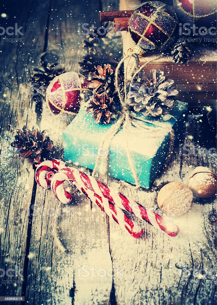 Box with Gifts on Wooden Background. Drawn Snow stock photo