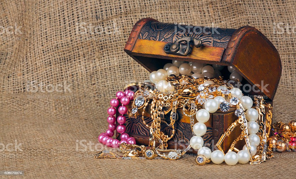 box with jewelry on sacking stock photo