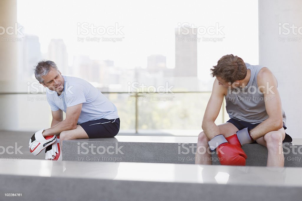 Boxer and coach resting after training royalty-free stock photo