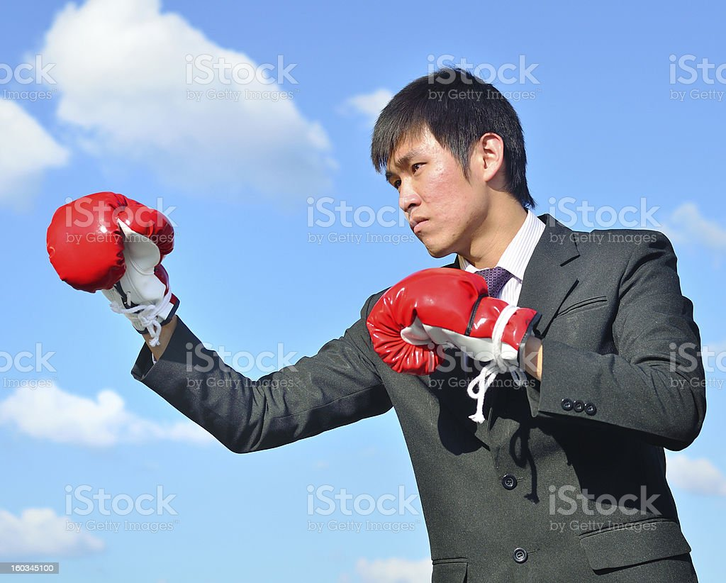 Boxer businessman ready to fight royalty-free stock photo