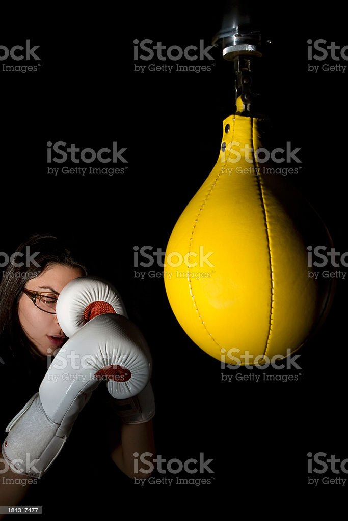 Boxer Concentrated to Yellow Speed Bag in Dim Light stock photo