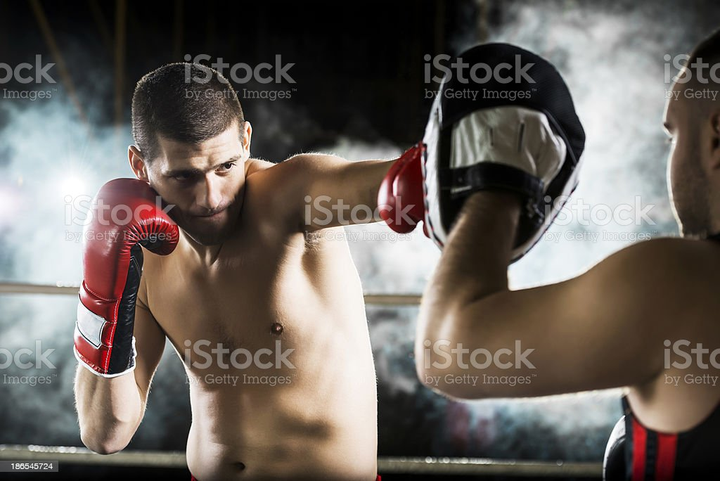 Boxer exercising with his instructor. royalty-free stock photo