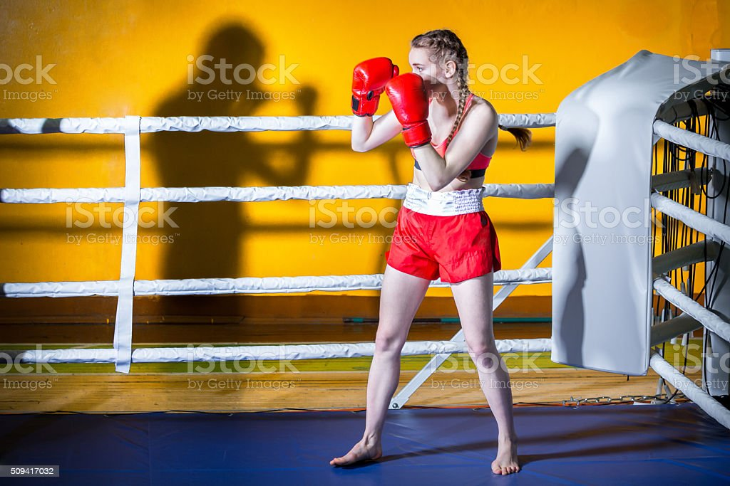 Boxer Girl And Shadow Sparring Partner stock photo