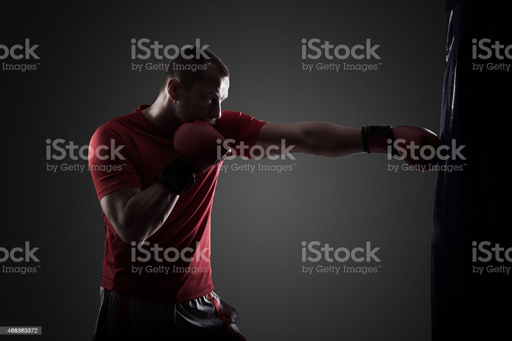 Boxer hits punching bag stock photo