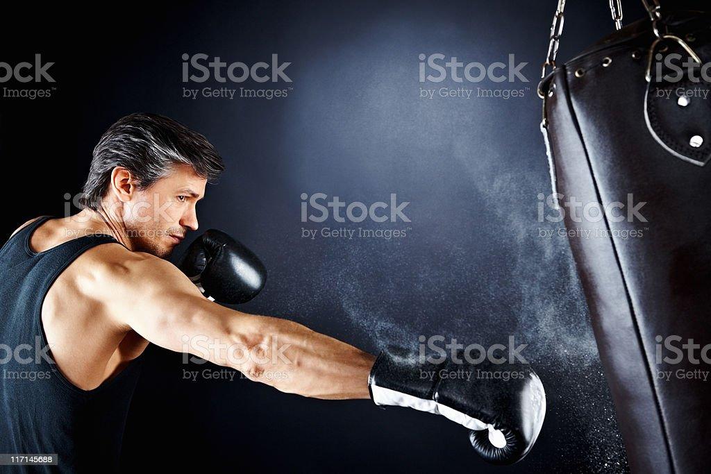 Boxer hitting punching bag stock photo