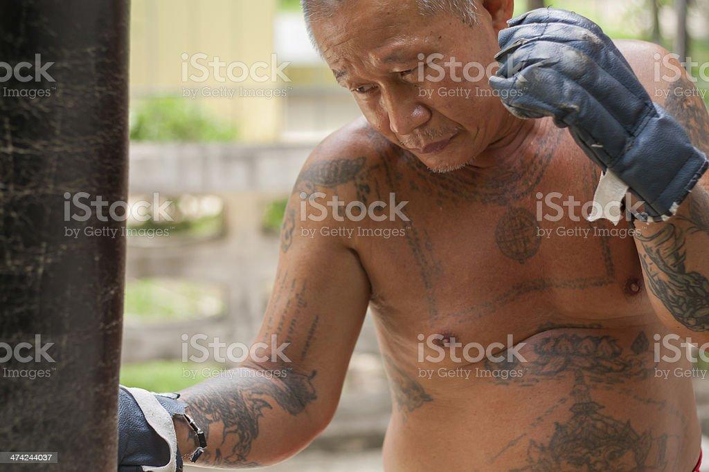 Boxer hitting the sandbag stock photo