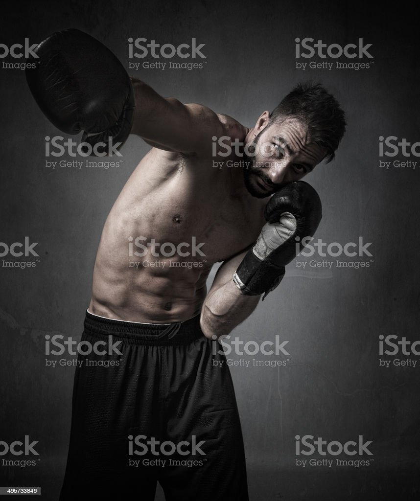 boxer hitting with gloves stock photo