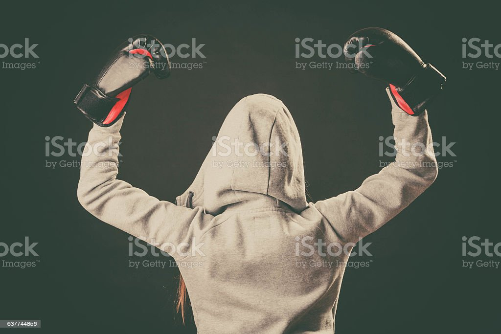 Boxer in hoodie stand backwards with arms in air. stock photo